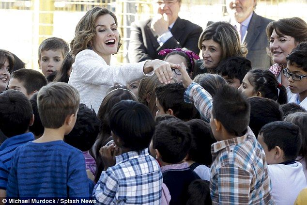 Mother-of-two Letizia received a rapturously warm reception from the primary school children who excitedly crowded around her and gave her high-fives