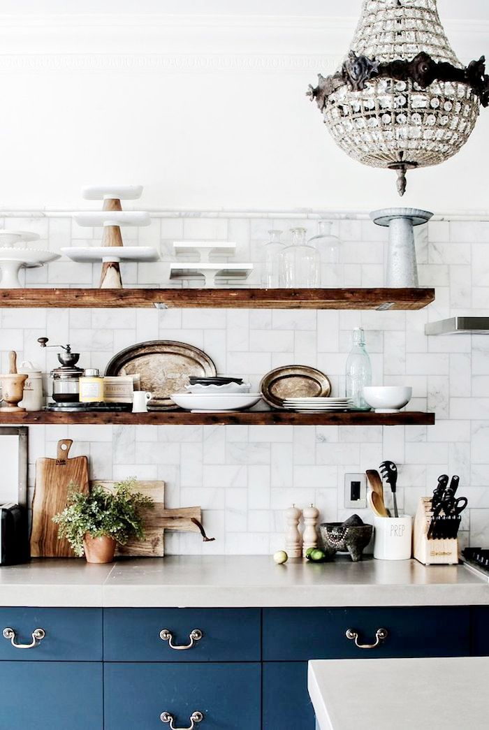 Open shelving in kitchen with chandelier