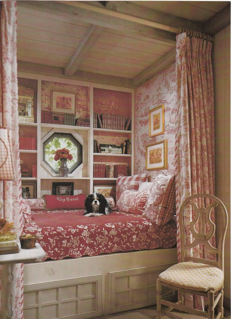 Nook with red and white toile, checks, stripes...and books. Couldn't you just curl up here for hours!