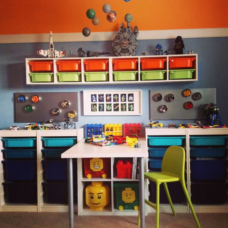 """Star Wars Lego Work Bench -  #Trofast Storage System + #Kallax Bookcase (2x2) + 30"""" wide melamine table top.  Worked perfect!    I wasn't in love the Trofast storage bin colors (only red, pink, and white at the store) so I bought the white ones and painted them in gradual blues, green, and orange with plastic-friendly Rustoleum.    I have really loved not having Legos all over the floor!   #IkeaHack"""