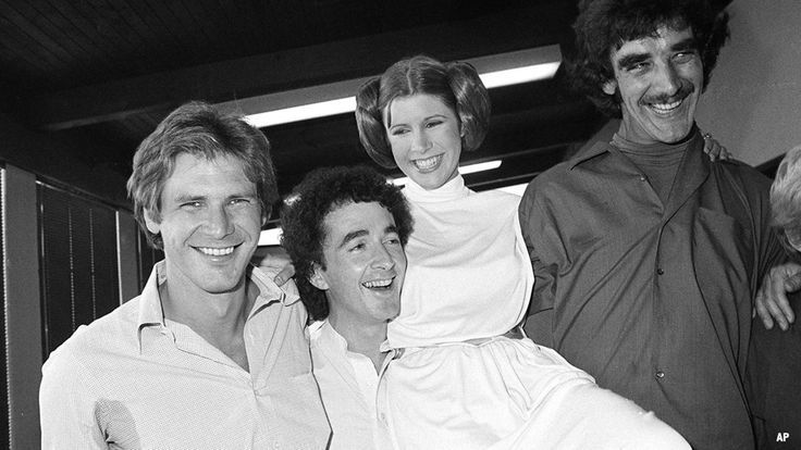 """Actor Harrison Ford, left, who played Han Solo in the move """"Star Wars,"""" is pictured with his co-stars, Anthony Daniels, who played C-3P0; Carrie Fisher who played Princess Leia, and Peter Mayhew who played Chewbacca the Wookiee"""
