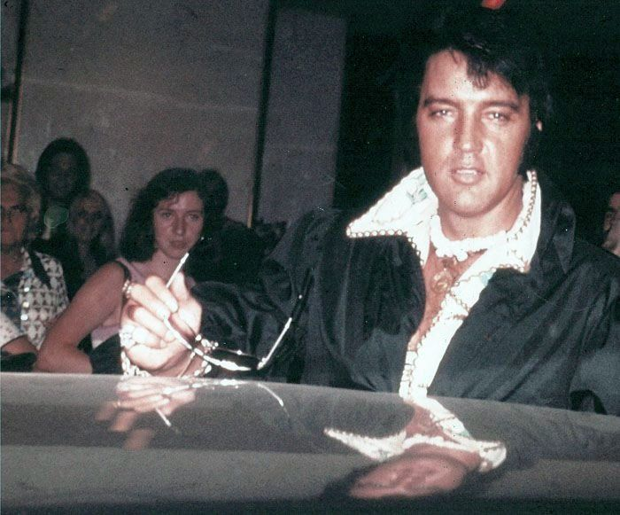 "Sept 1974 - ""The lady in the black hair looking at Elvis is Ann Shiels, who is an Irish lady that still regularly attends the Irish Elvis Social Club gatherings. I think this picture is used on the rear of the FTD release: ""It's Midnight""."" /FECC memphismartin"