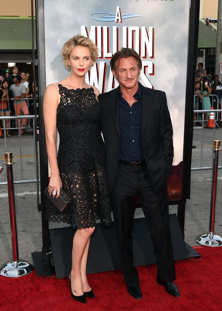 "Charlize Theron and Sean Penn arrive at the movie premiere of ""A Million Ways to Die in the West"" - May 15, 2014.  Theron and Penn began dating in December 2013, announced their engagement in December 2014, and ended the relationship in June 2015."