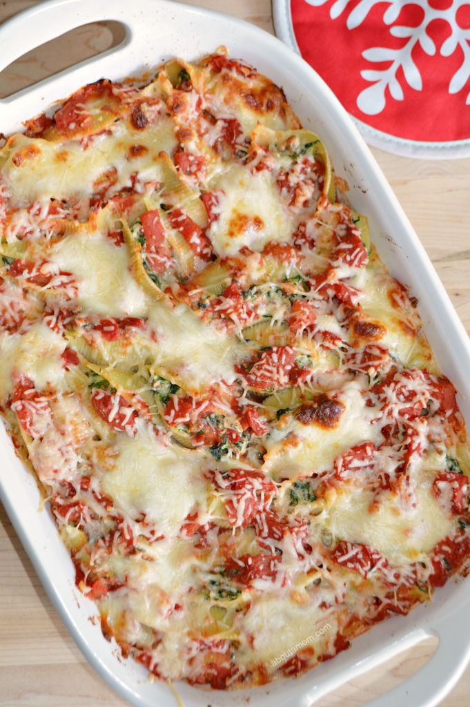 Italian Sausage, Spinach and Ricotta Stuffed Shells recipe. Jumbo pasta shells filled with a mixture of sweet Italian sausage, spinach and ricotta cheese. Smothered in a chunky red sauce and topped with Mozzarella and Parmesan cheeses. A worthy holiday recipe. from @aboutamom
