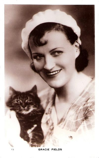 """Our Gracie"". Gracie Fields with cat accessory"