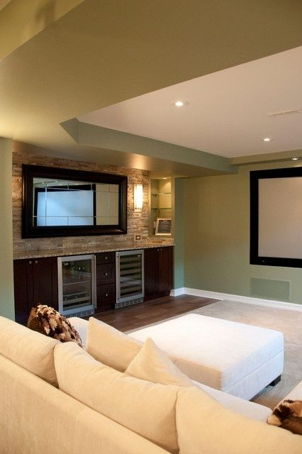 Love the built in bar and wine coolers in this cozy basement!