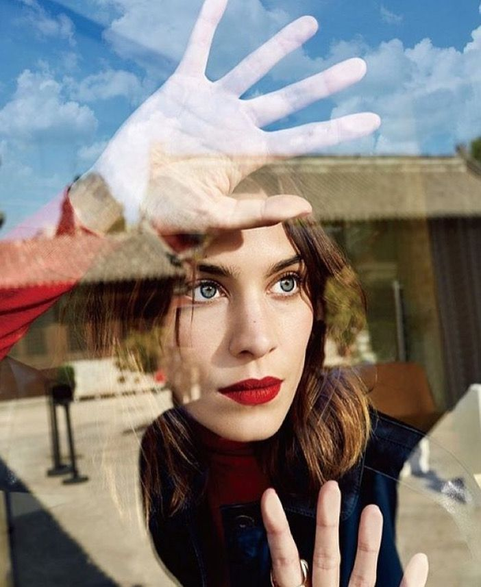 Alexa Chung portrait through window surrounded by exterior reflections