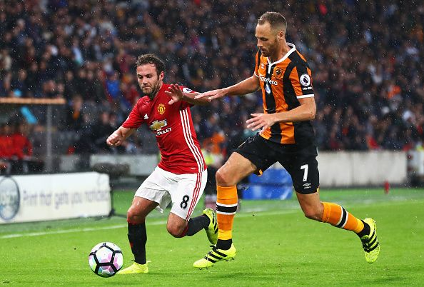 Juan Mata of Manchester United and David Meyler of Hull City battle for…