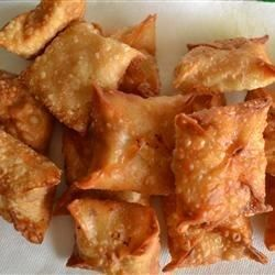 "Buffalo Wontons | ""Shredded chicken with buffalo sauce and cream cheese, wrapped up in a warm, crunchy wonton. These are easy and delicious. The perfect appetizer for a party or at home! I like to serve them with blue cheese or ranch dressing."""
