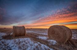 Broken Toe Sunset - sunset over hay bales in Saskatchewan Canada