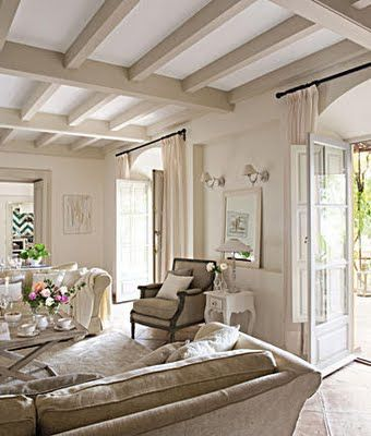 Neutral living area with an interesting paint treatment on the beamed ceiling.