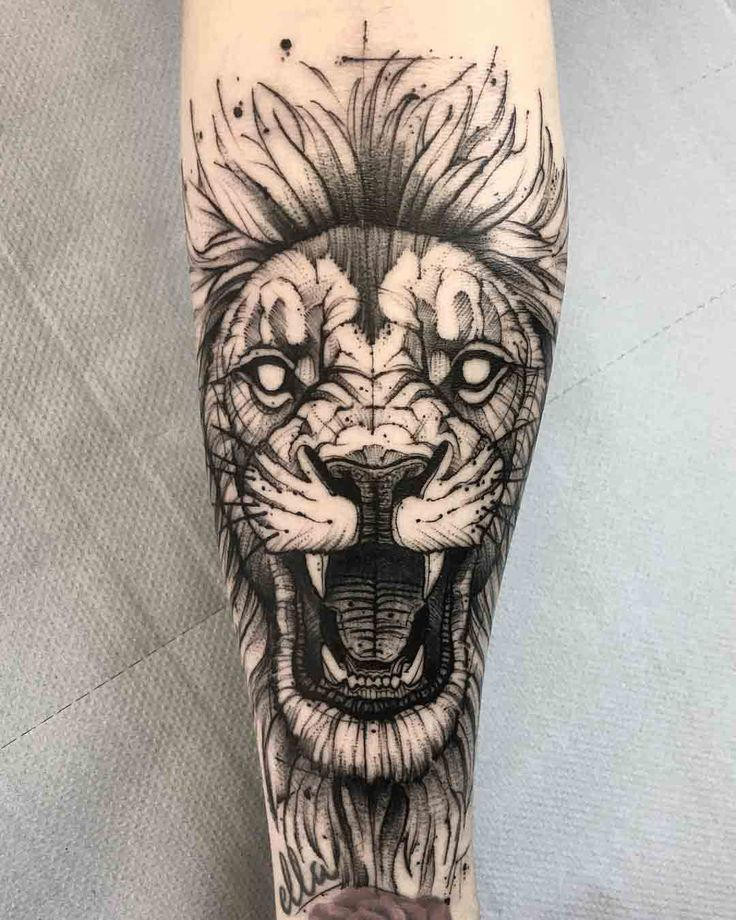 arm tattoo lion black and grey