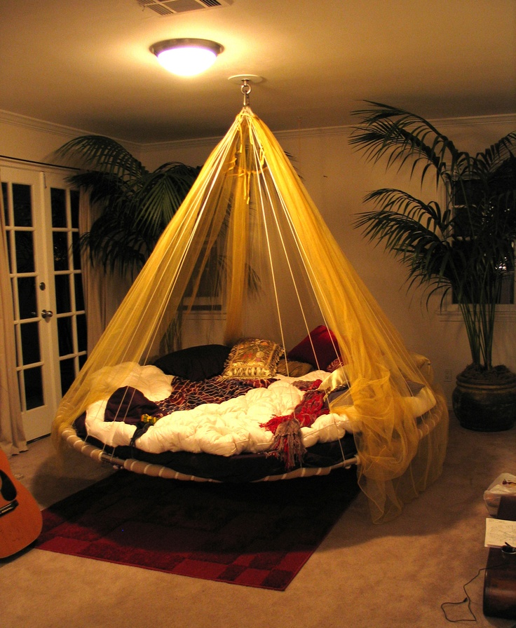 Canopy hanging bed creates bedroom decor.