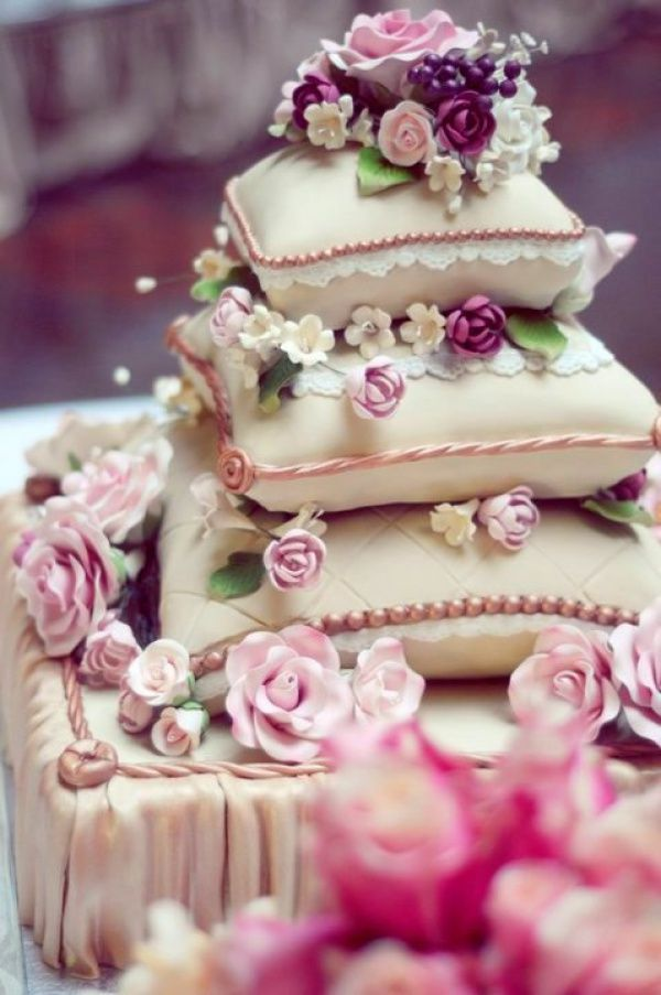 Pretty & Elegant Pillow Wedding Cake with many gorgeous Flowers! We totally love and had to share! Great CakeDecorating!