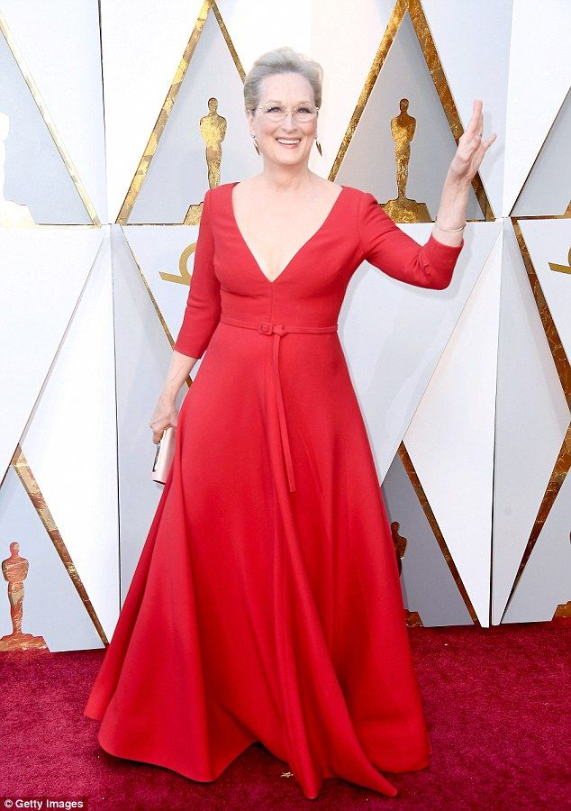 Giving a wave: The 68-year-old actress wore a scarlet, long-sleeved Christian Dior gown to... #oscars