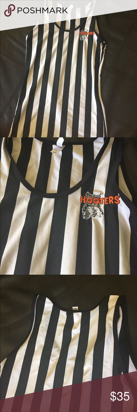 Hooters Referee Uniform Tank Top Stretchy racerback striped tank top. Hooters referee Uniform top features the original Hooters logo embroidered on the left hand side. Tank is very stretchy and can fit S-L. Size Small Hooters Tops Tank Tops