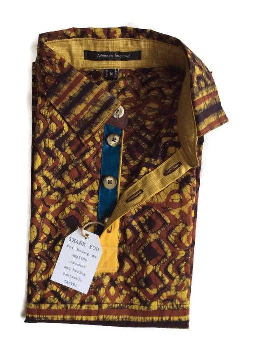 Check this out on my shop : Mens African Ankara Batik Print Shirt, Mens African Clothing, Short Sleeve Batik Shirt, Brown Mustard African Fabric Fitted Dress shirt, https://www.etsy.com/listing/557600501/mens-african-ankara-batik-print-shirt?utm_campaign=crowdfire&utm_content=crowdfire&utm_medium=social&utm_source=pinterest