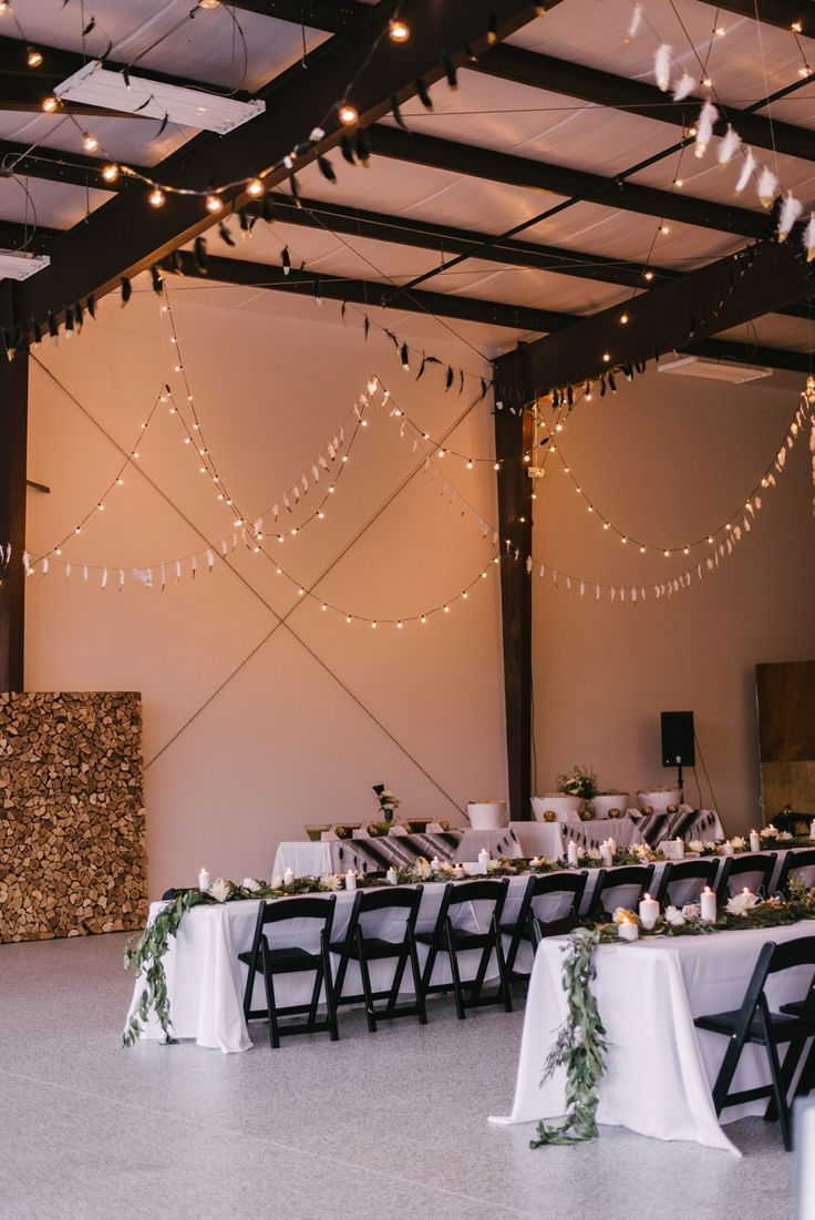 Italian bistro cafe string light rental for wedding reception in - Simple Romantic Wedding String Lights Tablesetting Alternative Modern Industrial Outdoor Airplane Hangar Wedding_0132