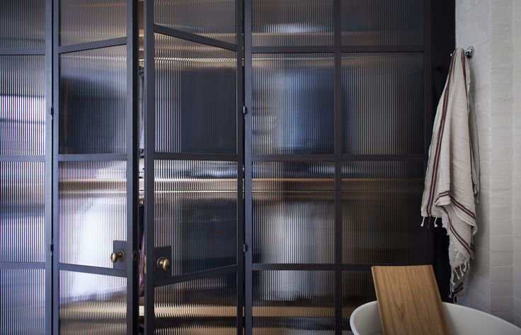 Bespoke Rolled Steel Glazed doors by Plain English. Bathroom Screens with reeded fluted glass.