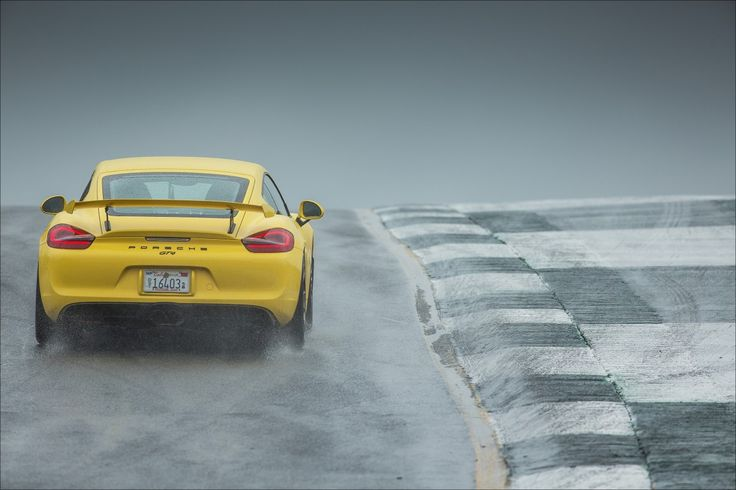 ABOVE: Cayman GT4, cresting in a hurricane downpour.