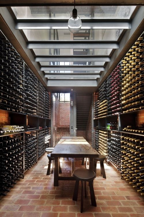 wine cellar! I want one of these one day in my basement, just looks so cool, and also a place you can hang around :D