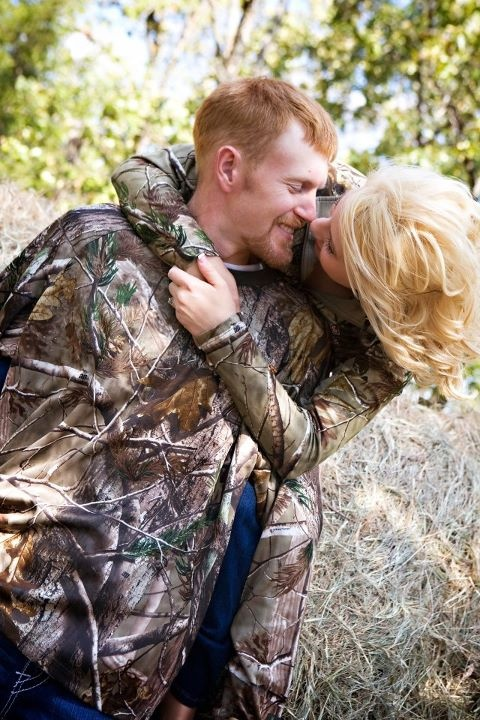 what i want one of our engagement pictures to look like. except I wanna be holding his gun with him behind me.. helping me hold it:)