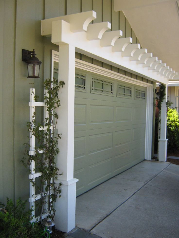 Garage Door Arbor - great way to increase curb appeal....I wonder how this would look on our house?