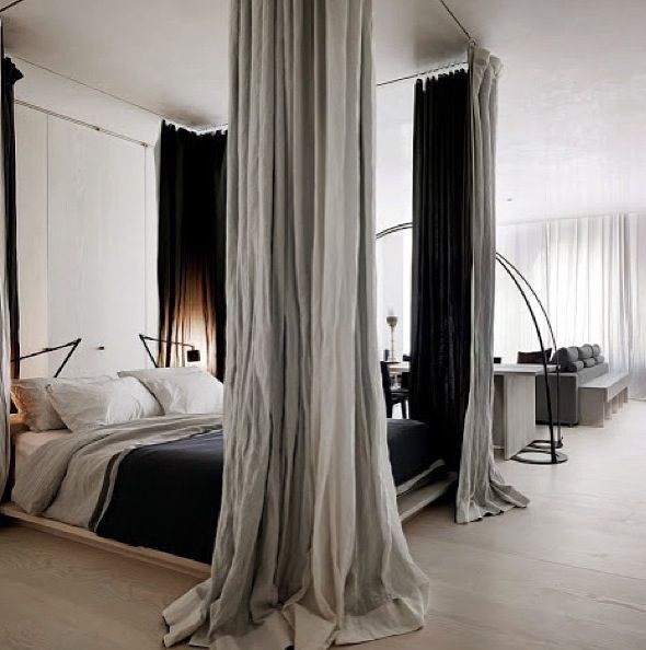 Fake four poster bed using curtain rods and curtains.