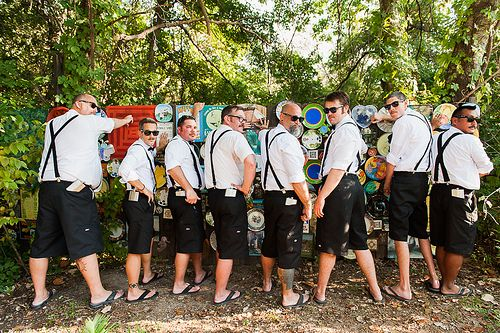 casual groomsmen attire, shorts, suspenders, flip flops and a button up shirt @Offbeat Bride