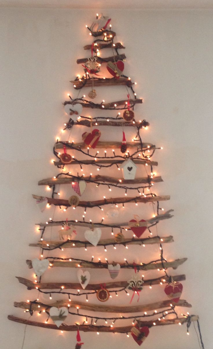 Reuse, repair and recycle Xmas :-) Stick Xmas tree with almost 100% home-made ornaments: dried oranges, wooden hearts, dried citruses, pine cone elves, fabric hearts and stars :-)