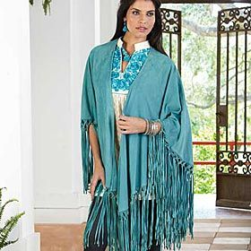 RIO GRANDE SUEDE SHAWL  The shawl has been in existence in a variety of forms since ancient times, serving the rich and poor as a protective garment against the biting cold. A beautifully hand crafted goat suede shawl in turquoise hues by Tasha Polizzi®. Long, hand tied fringe accents the ends of this large wrap around piece. Wear it as an accent piece or as a cover-up on chilly evenings. Imported. One size fits most.
