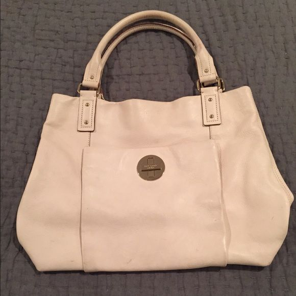Kate Spade Tote Bag Kate Spade Tote Bag. Color is cream. Light wear on handles and bottom edges. A few light marks on front and one larger mark on back. But overall the bag is in great condition. kate spade Bags Totes