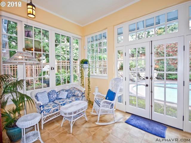 Cheerful, Yellow Sunroom With Blue Accessories.