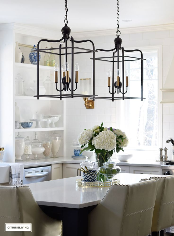 Bright and airy kitchen with lantern style pendant lighting over the island