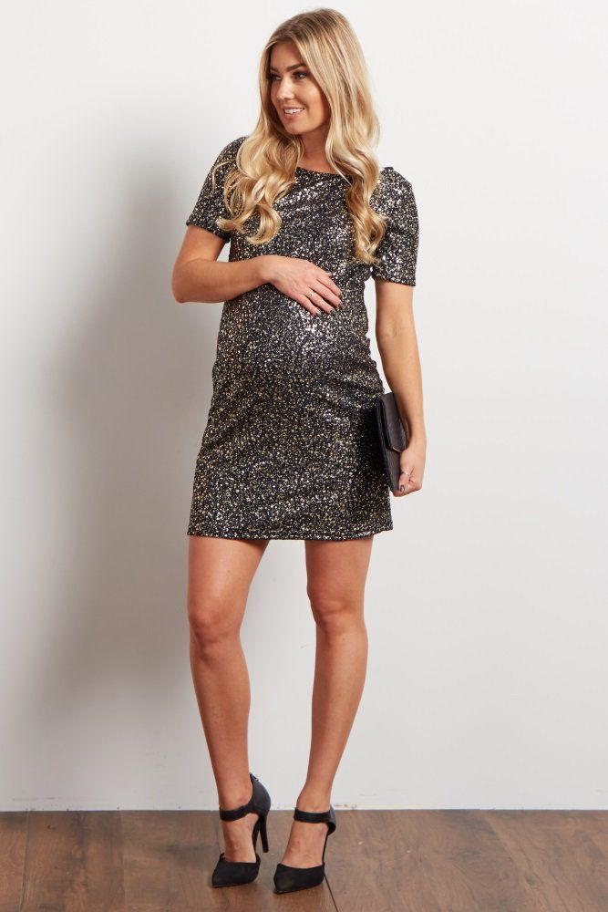Party it up with this very fun and shiny fitted maternity mini dress. The metallic detail on this dress adds an element of glamour and sparkle. Pair this with a great heel and statement necklace for your fun night out.