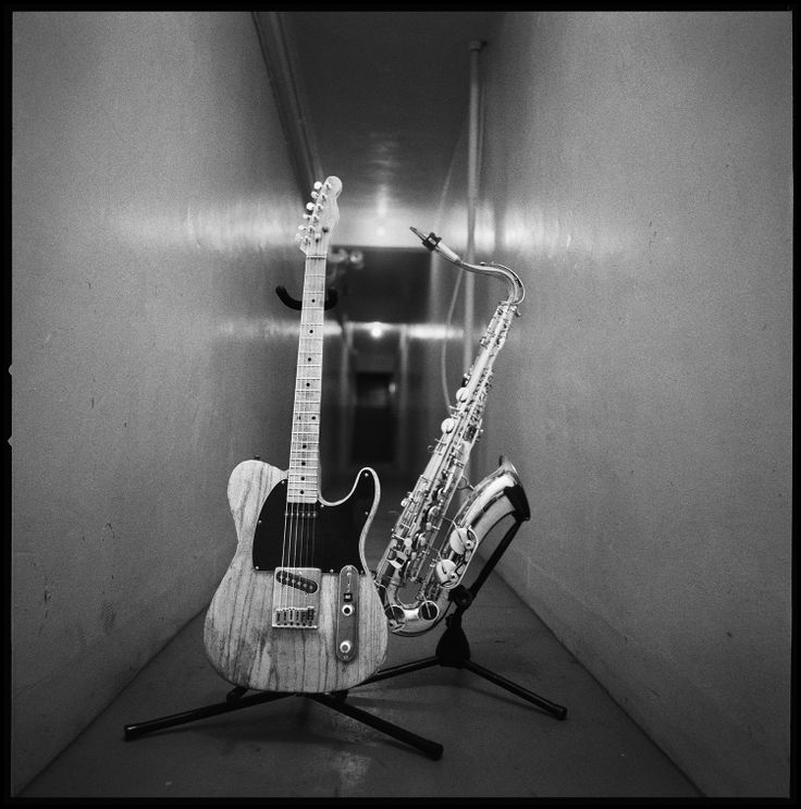 Bruce Springsteen's Guitar with Clarence Clemons' Saxophone, 2000 by Danny Clinch