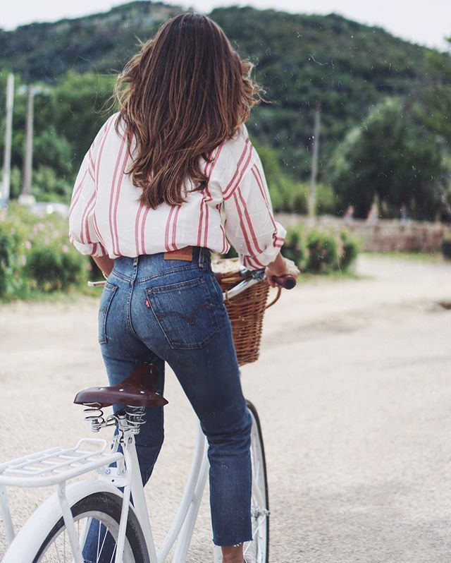 Reinvent high-waist, mom jeans with @stylecaster's street style round-up | red and white striped blouse, medium-wash denim
