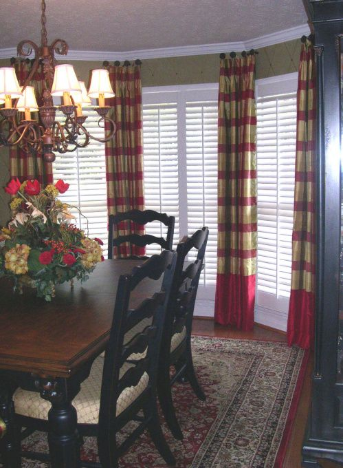 Medallion On Post Mounted Draperies With Deep Contrast Hem In This Beautiful Bay Window Treatment