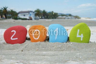 Happy 2014 with colourful stones and beach background