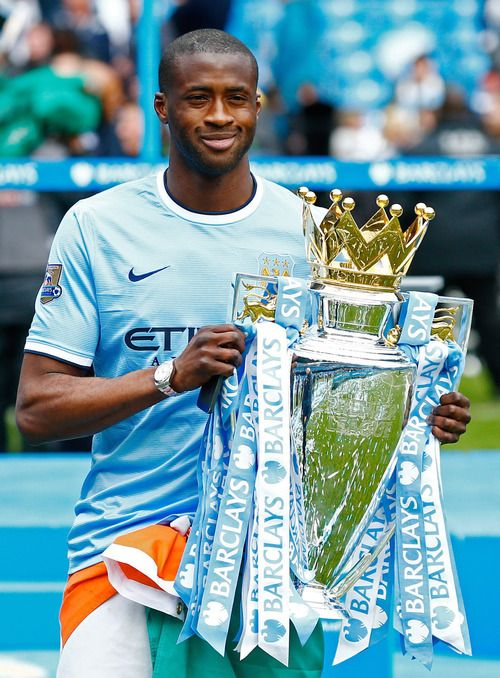 Man City's Yaya Toure with the Premier League trophy.