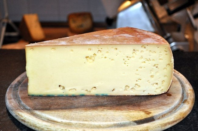Fontina Valdostana, from Valle D'Aosta, Italy, is dense, smooth and slightly elastic. The straw-colored interior with its small round holes has a delicate nuttiness with a hint of mild honey. When melted, as it frequently is, the flavor is earthy, woody, with a taste of mushrooms and a fresh acidity. It pairs exceedingly well with roast meats and truffles. This cheese also pairs well with a burly red wine.  is the primary ingredient of Italian fonduta and is a pristine table or dessert…