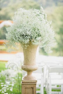 Baby's Breath | Large Urn Arrangement | On SMP: http://www.stylemepretty.com/georgia-weddings/dahlonega/2012/10/11/dahlonega-wedding-at-white-oaks-barn-from-amy-arrington-photography  Amy Arrington Photography