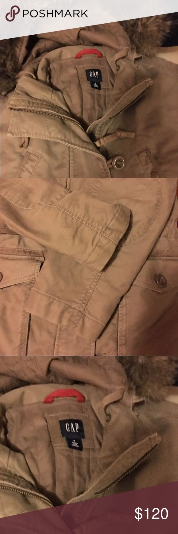 NWOT GAP COAT Gap women's small coat. Never used just had stored in closet. Runs big. Can fit up to medium very warm and fur trimming on hat, can be removed GAP Jackets & Coats Utility Jackets
