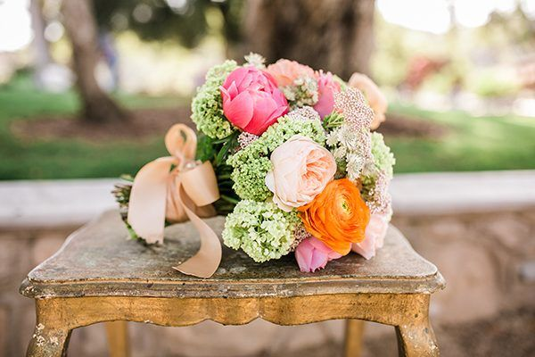 hot pink and orange bouquets - photo by Camarie Photography http://ruffledblog.com/whimsical-horse-play-wedding-inspiration