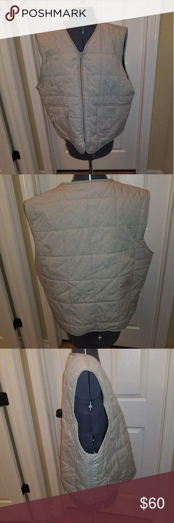 North Face quilted vest Mens tan Pre Owned North Face Mens quilted vest.   I think that this was a XL but the size tag was removed. If measurements are needed message me  No tears, or stains. Other than missing tag it was never worn and was just in the closet  - 2 front pockets - zip front North Face Jackets & Coats Vests