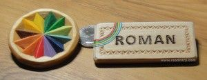 Chip carving examples: photo of a small chip carved rosette and a chip carved name badge.