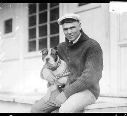 """Jack Dempsey & Dog  Jack Dempsey was an American boxer who held the world heavyweight title from 1919 to 1926. He was said to have been an """"enthusiastic"""" pit bull advocate.    Chicago Daily News negatives collection. Courtesy of Chicago History Museum."""