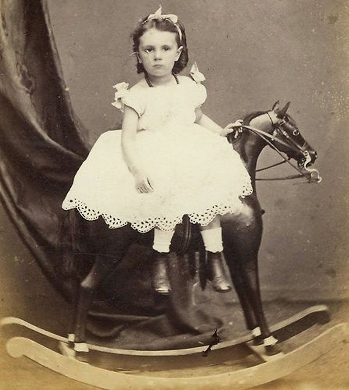Early photographs took a long time to make and people needed to stand and pose. So people are just tired, especially children, and appear to be sad in the photo. Here are a few examples of such photographs of the Victorian era.