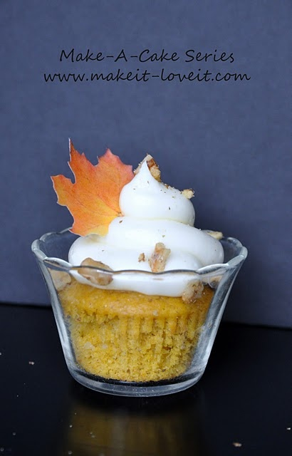 Caramel Soaked Pumpkin Cupcakes with Cream Cheese Frosting and Toasted Walnuts.