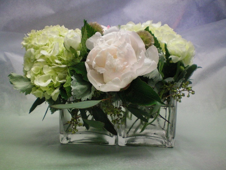Centerpiece Of White Hydrangea Peonies And Scabiosa Pods